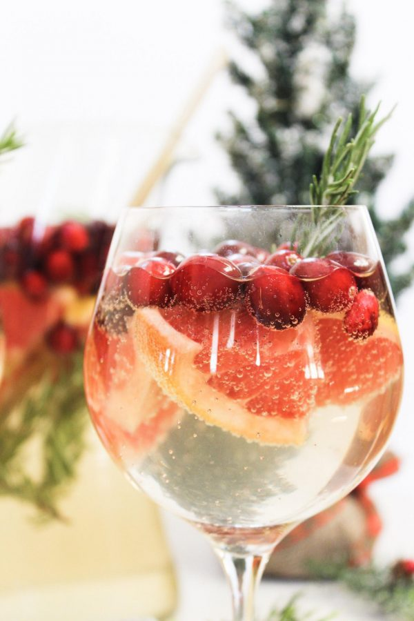 Delicious holiday white wine sangria recipe. The best holiday recipes for any holiday party.